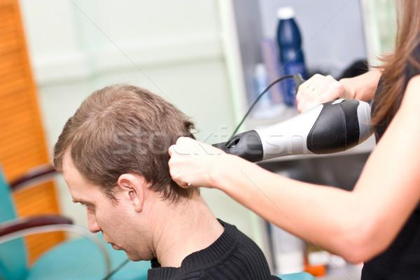 Hairdresse dry guy hair Stock photo © podsolnukh