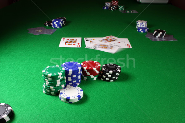 Quad Kings - Action shot on a poker table Stock photo © PokerMan