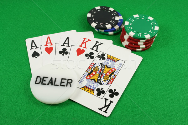 Stock photo: Full House with a dealer chip on top