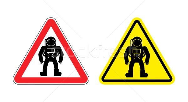 Astronaute danger jaune signe cosmique Photo stock © popaukropa