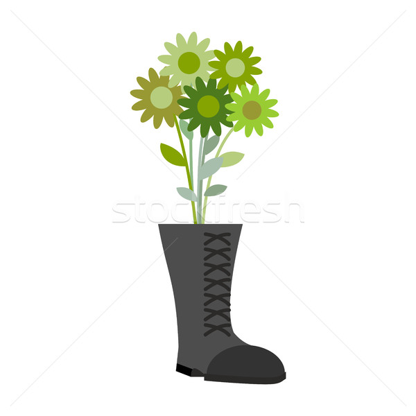 Soldiers shoes and bouquet of military greens flower. Gift for m Stock photo © popaukropa