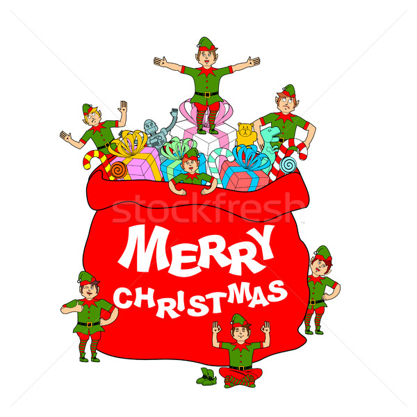 f88b4e30b6944  7677072 Merry Christmas. Santa bag with gift and elves. Big red sack for  by popaukropa Stock photo