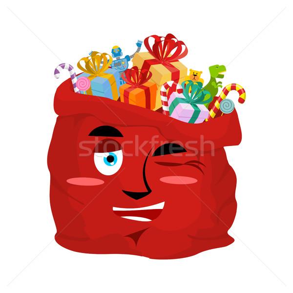 Santa bag winks Emoji. Christmas sack with gifts merry emotion.  Stock photo © popaukropa