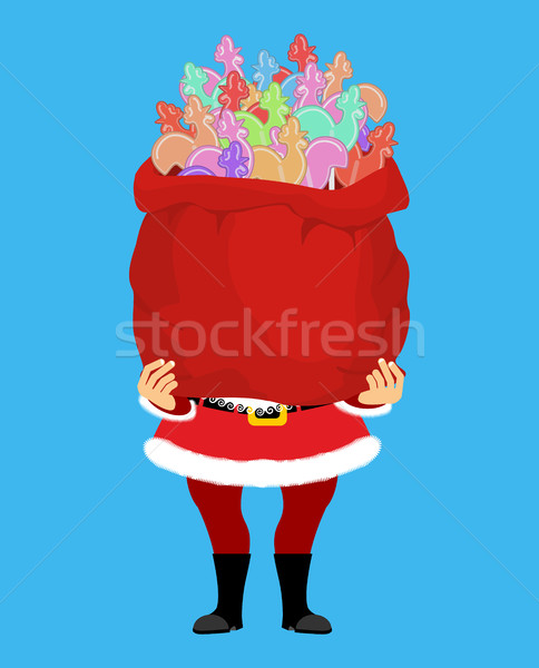 Santa Claus and bag of Cockerel candy. Christmas sack and lollip Stock photo © popaukropa