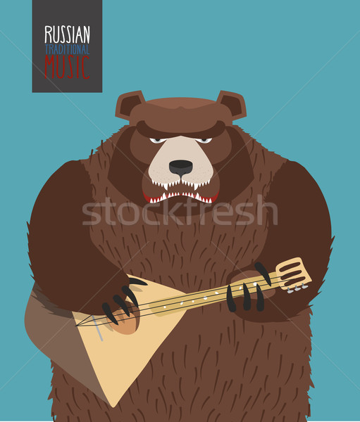 Bear was playing the balalaika. Russian national musical instrum Stock photo © popaukropa