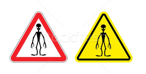 Warning sign of attention aliens. Hazard yellow sign space invad Stock photo © popaukropa