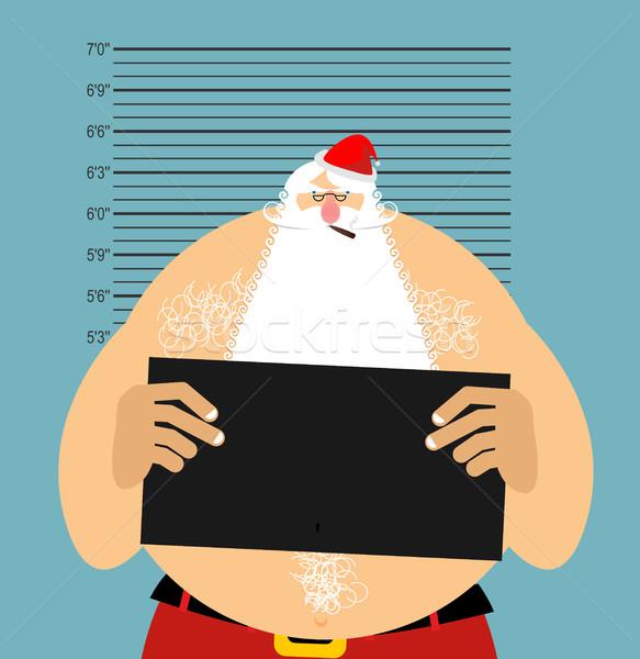 Mugshot Santa in police. Bad Claus criminal. Naughty Santa with  Stock photo © popaukropa