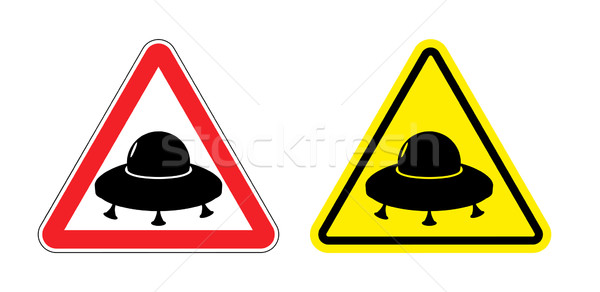 Warning sign of a UFO. Hazard yellow sign flying saucer. Silhoue Stock photo © popaukropa