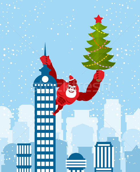 Big Red Gorilla dressed as Santa Claus climbs the building with  Stock photo © popaukropa