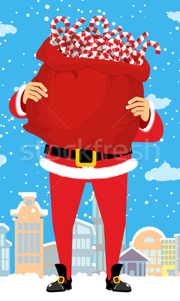 Santa Claus and bag of Christmas peppermint lollipop. Christmas  Stock photo © popaukropa