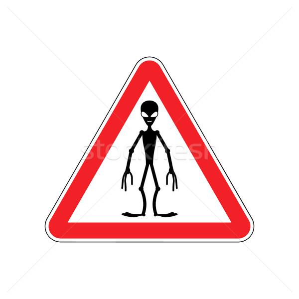 UFO Warning sign red. Alien Hazard attention symbol. Danger road Stock photo © popaukropa