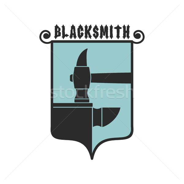 Blacksmithing emblem. Logo for smithy. Wrought iron. Hammer and  Stock photo © popaukropa