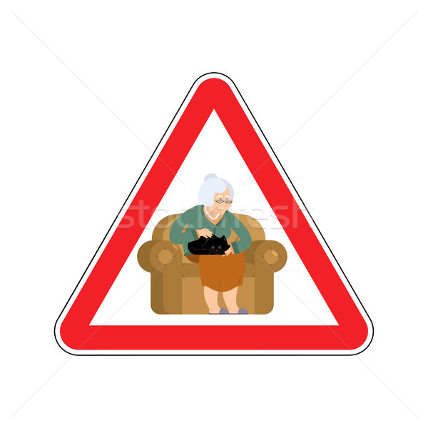 Attention grandmother. Caution old woman and cat. Red triangle r Stock photo © popaukropa