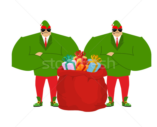 Santa elf and red bag. Claus bodyguards. Christmas guards. Prote Stock photo © popaukropa