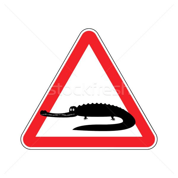 Attention crocodile. Alligator on red triangle. Road sign Cautio Stock photo © popaukropa