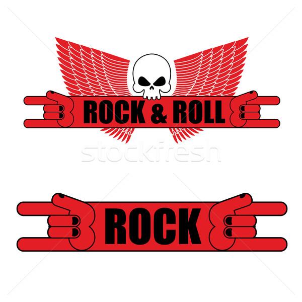 Rocha rolar logotipo sinal da mão asas música Foto stock © popaukropa