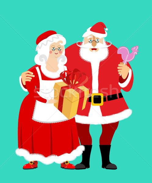Santa and Mrs. Claus isolated. Christmas family. Woman in red dr Stock photo © popaukropa