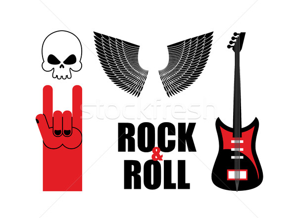 Set symbol rock music . Skull and wings, guitar and rock hand si Stock photo © popaukropa