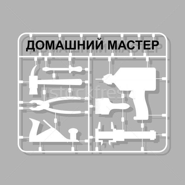 plastic model kits Construction tools. Russian translation  text Stock photo © popaukropa