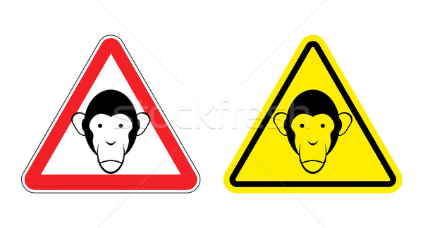 Warning sign attention monkey. Hazard yellow sign head monkeys.  Stock photo © popaukropa