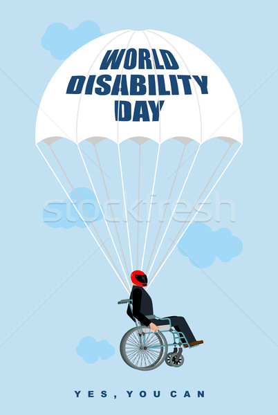 World Disabilities day. Man in  wheelchair goes down on parachut Stock photo © popaukropa