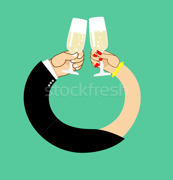 Stock photo: Wedding. Male and female hand to drink wine to clink