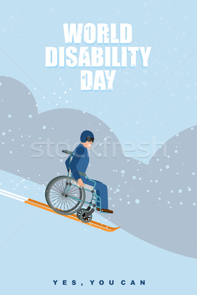 Stock photo: World Disabilities day. Man in wheelchair goes to skiing down  m