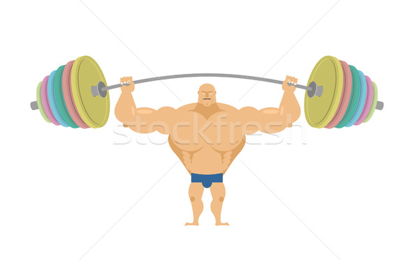 Bodybuilder raises sports barbell with colored discs. Bench pres Stock photo © popaukropa