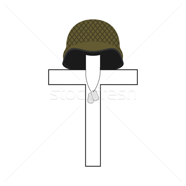 Grave of soldier. Cross and military helmet. Soldier badge. Patr Stock photo © popaukropa