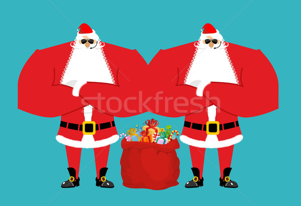 Santa Claus bodyguards. Christmas security guards. Protecting re Stock photo © popaukropa