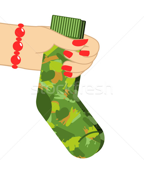 February 23. Female hand to give socks. Traditional gift for mil Stock photo © popaukropa