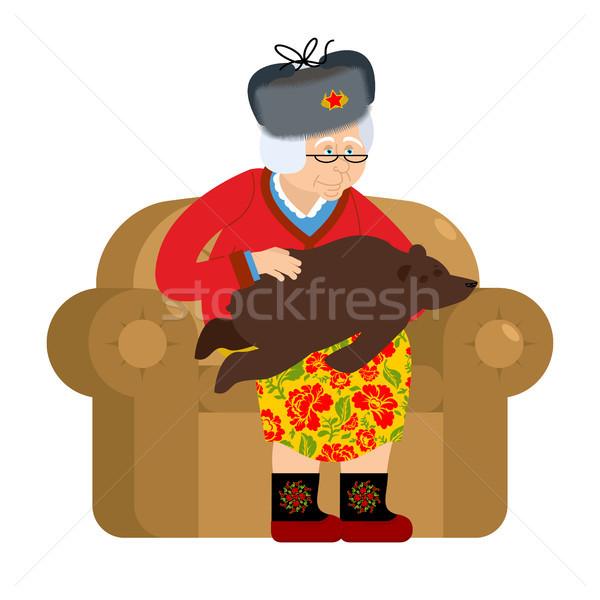 Stockfoto: Russisch · grootmoeder · beer · huisdieren · oude · vrouw · fauteuil