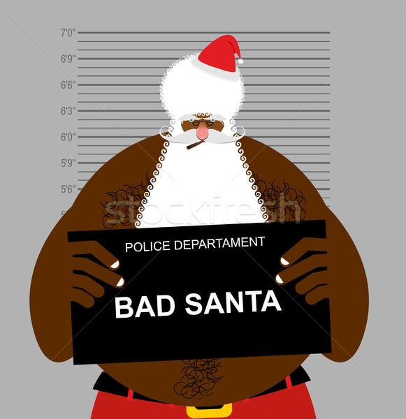African American Santa at police station. Mugshot Black Santa ga Stock photo © popaukropa