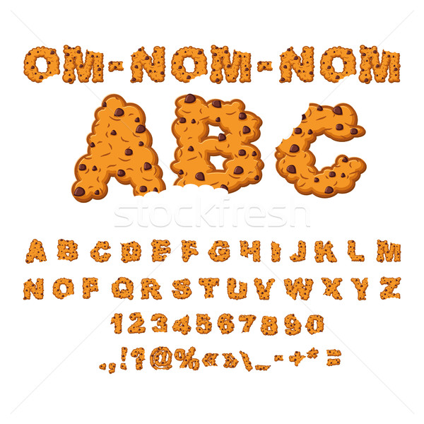 Om nom nom ABC. Cookies font. Biscuits with chocolate Drops alph Stock photo © popaukropa