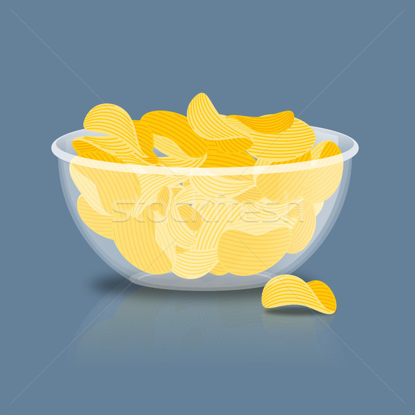 Potato Chips in bowl. Fried potatoes in deep transparent plate.  Stock photo © popaukropa