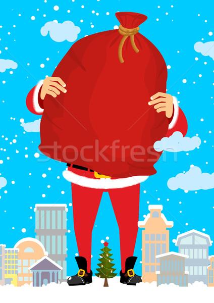Święty mikołaj miasta worek prezenty christmas Zdjęcia stock © popaukropa