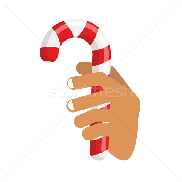 Hand and Candy Cane. Arm holding Christmas peppermint lollipop.  Stock photo © popaukropa