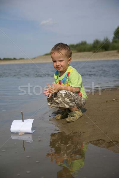 Boy with a sailboat Stock photo © Pozn