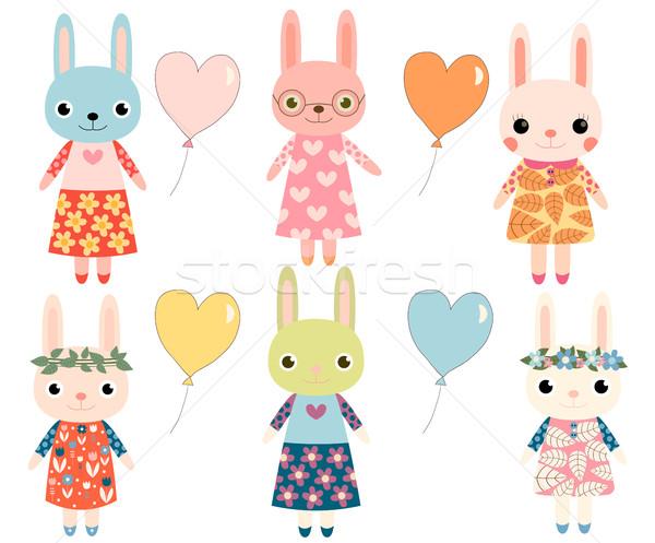Cute colorful cartoon bunnies with heart shaped balloons Stock photo © Pravokrugulnik
