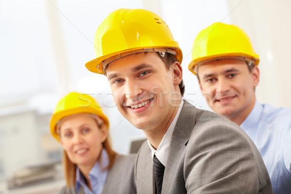 Stock fotó: építész · mosolyog · sisak · kettő · kollégák · üzlet