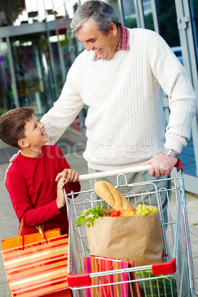 Сток-фото: портрет · деда · внук · товары · супермаркета