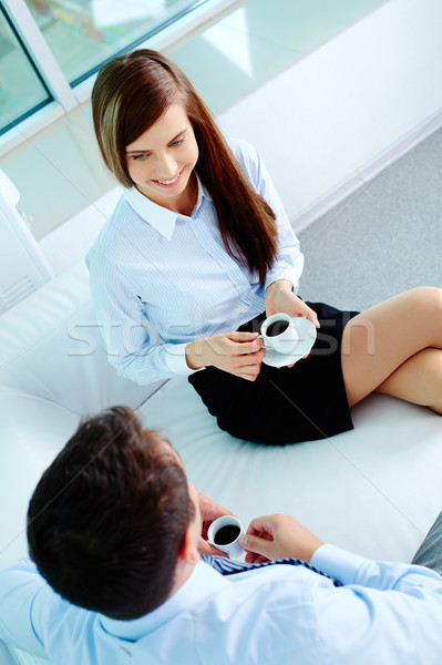 Barátságos párbeszéd fotó üzleti partnerek beszél iszik Stock fotó © pressmaster