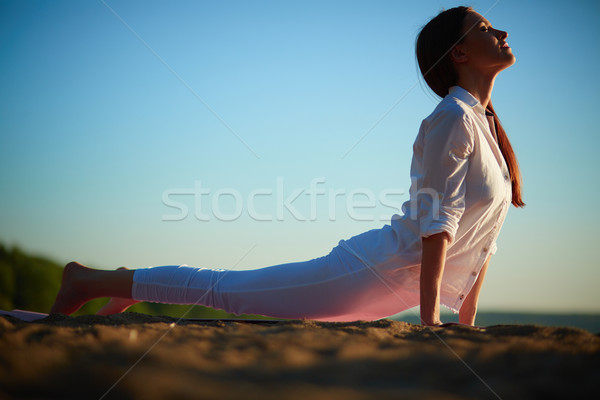 Stretching on sand Stock photo © pressmaster