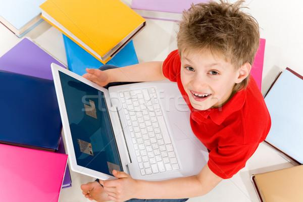 Boy with laptop Stock photo © pressmaster