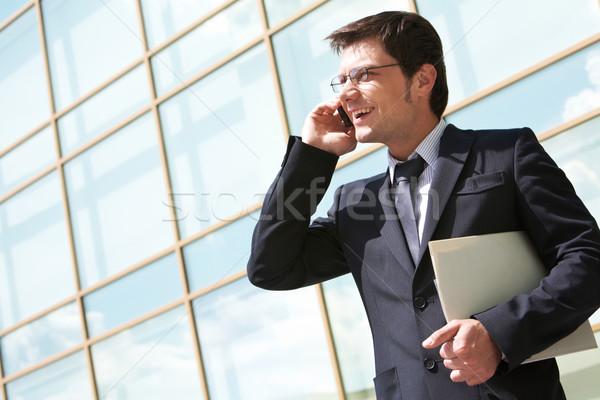 Telekommunikáció fotó jóképű munkáltató beszél mobiltelefon Stock fotó © pressmaster