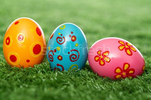 Gekleurde eieren gazon drie paaseieren Pasen voedsel Stockfoto © pressmaster