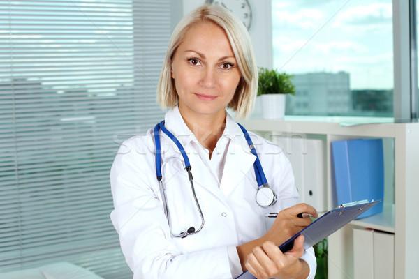 женщины практикующий врач портрет довольно глядя камеры Сток-фото © pressmaster