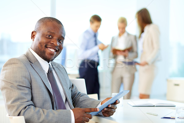 Işadamı touchpad portre mutlu lider bakıyor Stok fotoğraf © pressmaster