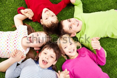 Children on grass Stock photo © pressmaster