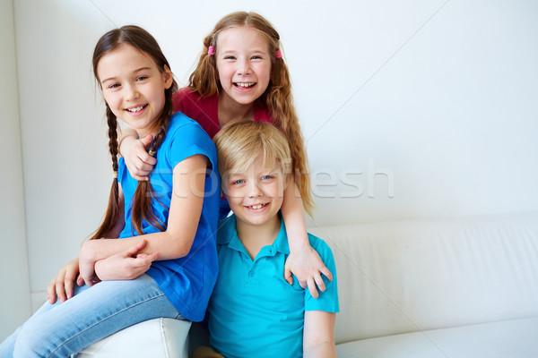 единения три привязчивый дети глядя камеры Сток-фото © pressmaster